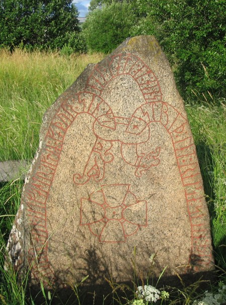 11th century runestone at Knivsta, south of Upssala, Sweden. The runestone reads: 'Ástríðr lét reisa stein þenna eptir Jóar/Ívar, bónda sinn, ok Ingvarr ok Ingifastr eptir fôður sinn. Mikjáll gæti ônd hans.' Translation: 'Ástríðr had this stone raised in memory of Jóarr/Ívarr, her husbandman; and Ingvarr and Ingifastr in memory of their father. May Michael protect his spirit.' Image source: www.commons.wikimedia.org