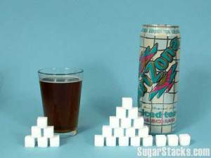 image depicting how many sugar cubes are in a glass of coke and a can of arizona sweet tea