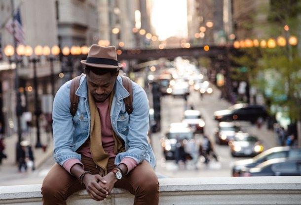 black man sitting on the street