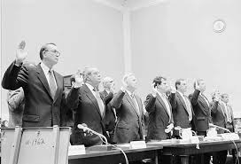 Tobacco execs testifying before Congress that nicotine is not addictive