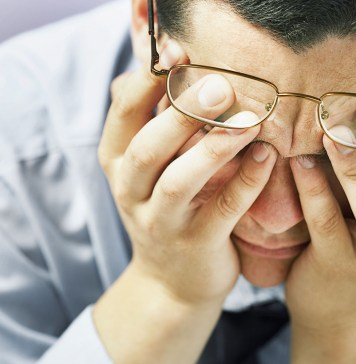 stressed man with hands on face