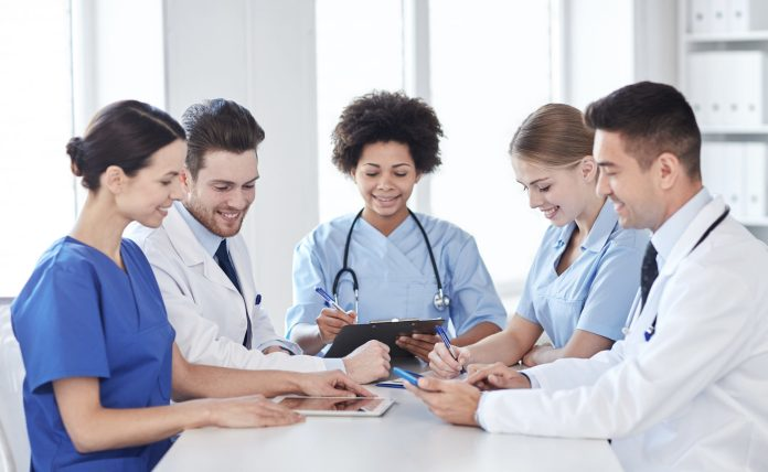 Shared vision: Group of doctors seated around a table 2048 x 1259