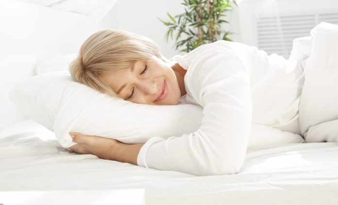 Power naps: woman sleeping in white bed 2048 x 1239