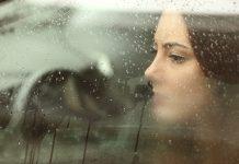 Sad woman looking through a steamy car window 2048 x 1365