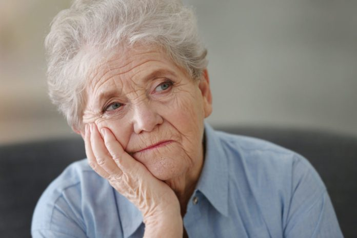 Depressed elderly woman at home 2048 x 1365