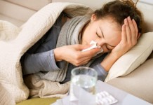 Women in bed with flu