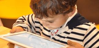Boy looking at iPad 797 x 529
