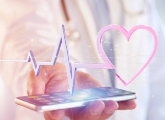 Doctor holding smartphone with EKG in foreground 1500 x 965