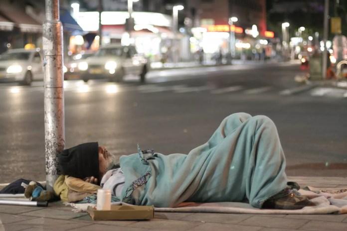 male homeless sleeping in a street 1500 x 1000