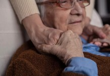 Senior man holding hands of older woman 1000 x 667