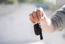 Male hand dangling car keys 1500 x 1000