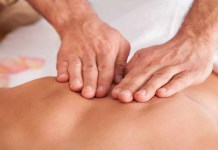 Male masseuse with female client