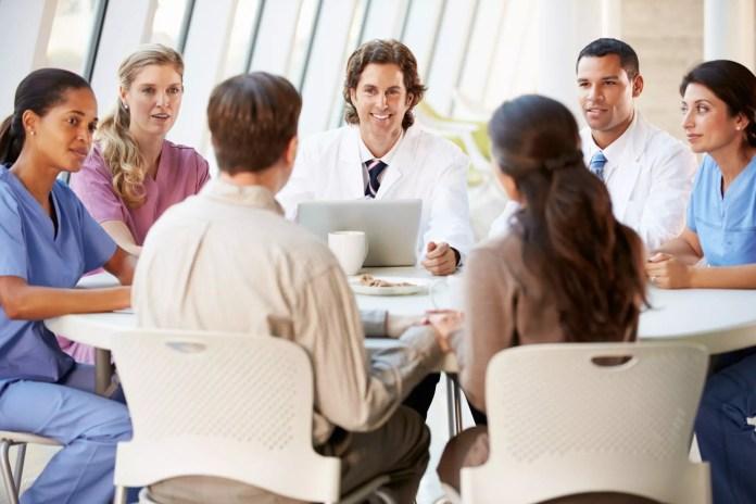 medical team patient discussion 2121 x 1414