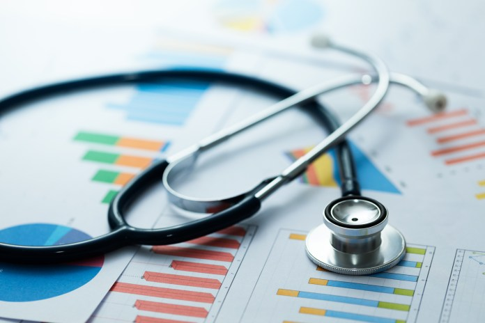 high-value healthcare - medical statistics and graphic charts with stethoscope 2000 x 1333 (Deposit Photos)