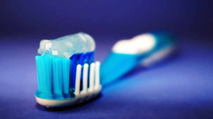 blue toothbrush and toothpaste 2048 x 1150
