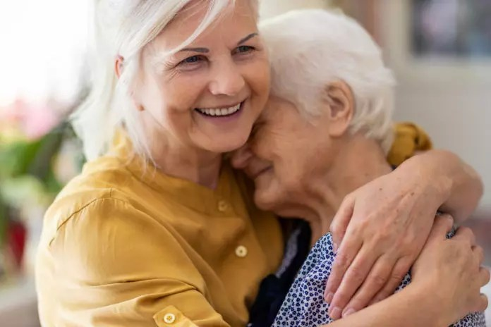 senior woman hugging elderly mom - emotional health
