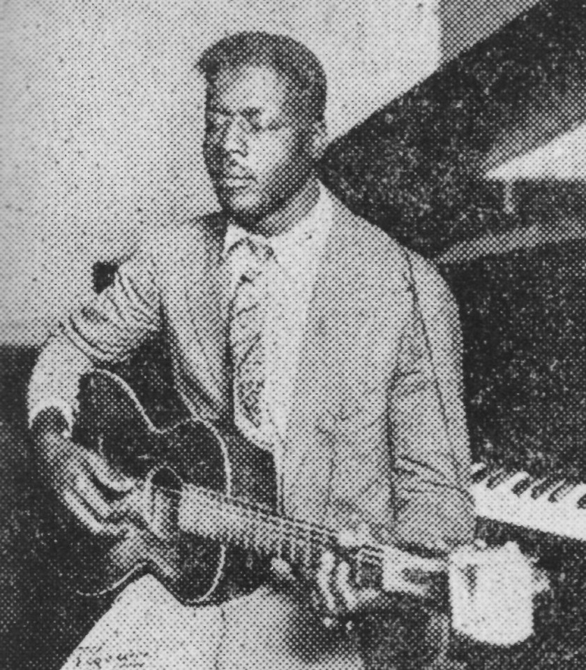 Blind Willie Nelson playing blues guitar