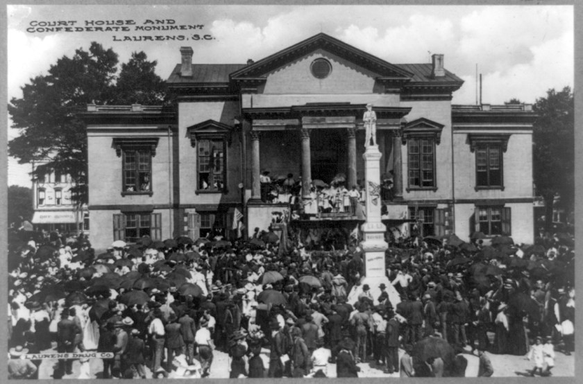 Laurens County Courthouse and Confederate monument in Laurens, South Carolina, ca., 1900.