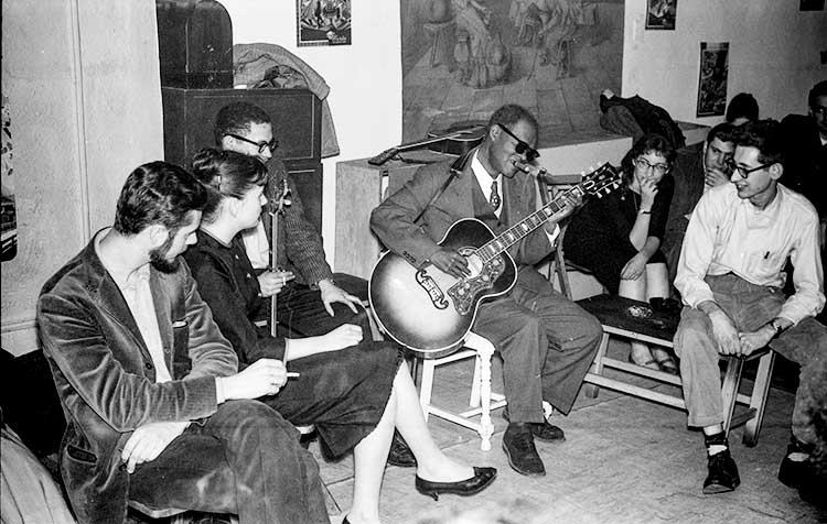 Reverend Gary Davis entertains guests at a party for his 63rd birthday, in 1959