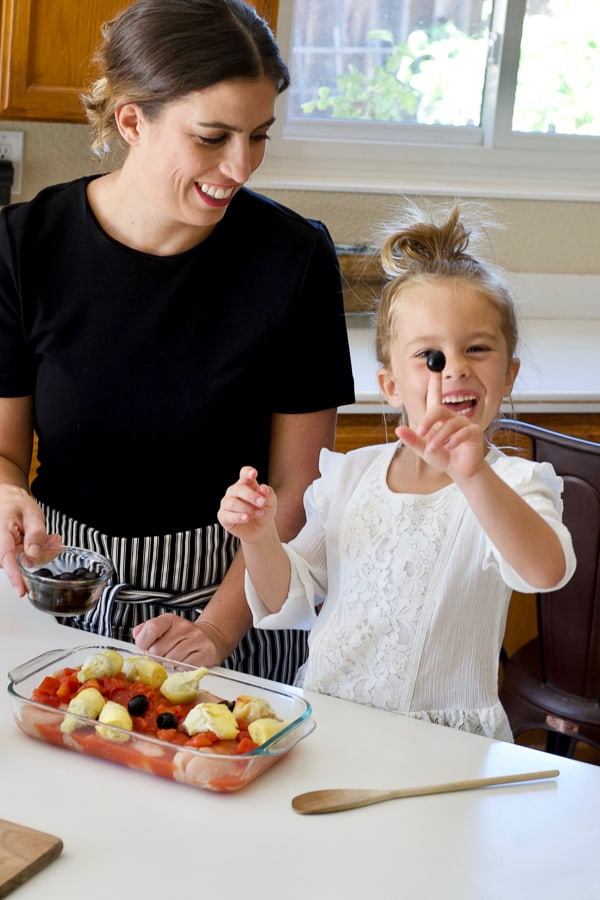 mom and daughter in kitchen learning to cook mediterranean diet inspired recipes