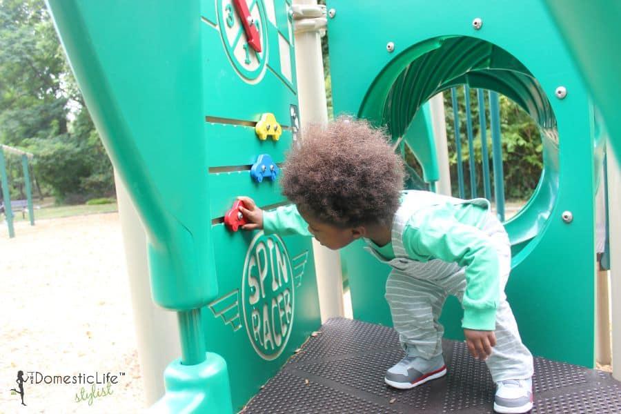 boy in carter's on playground