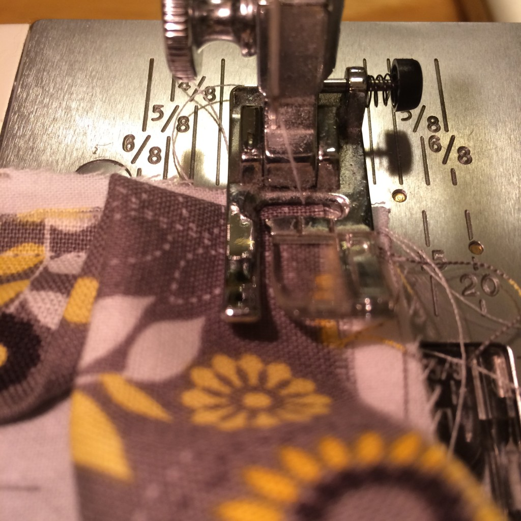 How to Sew an Ironing Pad | A Domestic Wildflower click through to read this tutorial for working with ironing board fabric and how to sew a mitered corner!
