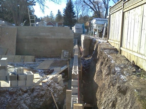Foundation extending from old house to new addition