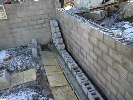 New front foundation wall to comply with the city's request to move it a whole EIGHT INCHES!
