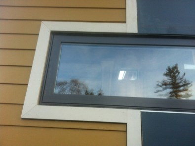 Close up of where the HardiePlank siding & HardiePanels meet at the window.