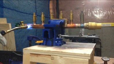 Soldering a manifold for our radiant system