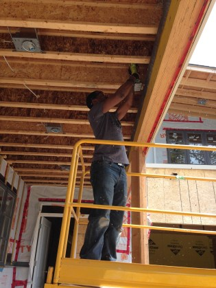 Kes drilling the holes for our pex runs