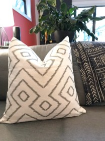 Completed throw pillow cover in Baraka Ikat Grey fabric from Tonic Living