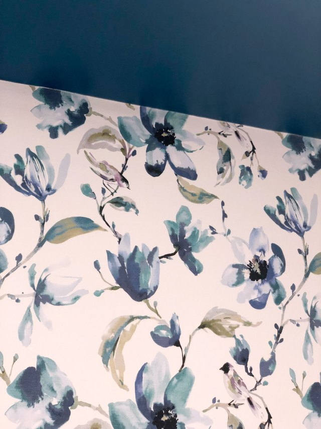 DIY Fabric Wallpaper using the beautiful Layla fabric in indigo from Tonic Living creates a perfect accent against the painted ceiling in the powder room