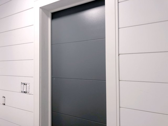 Metrie Option M modern shiplap installed along the door wall