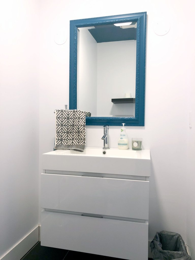 The powder room before: stark white with very little personality