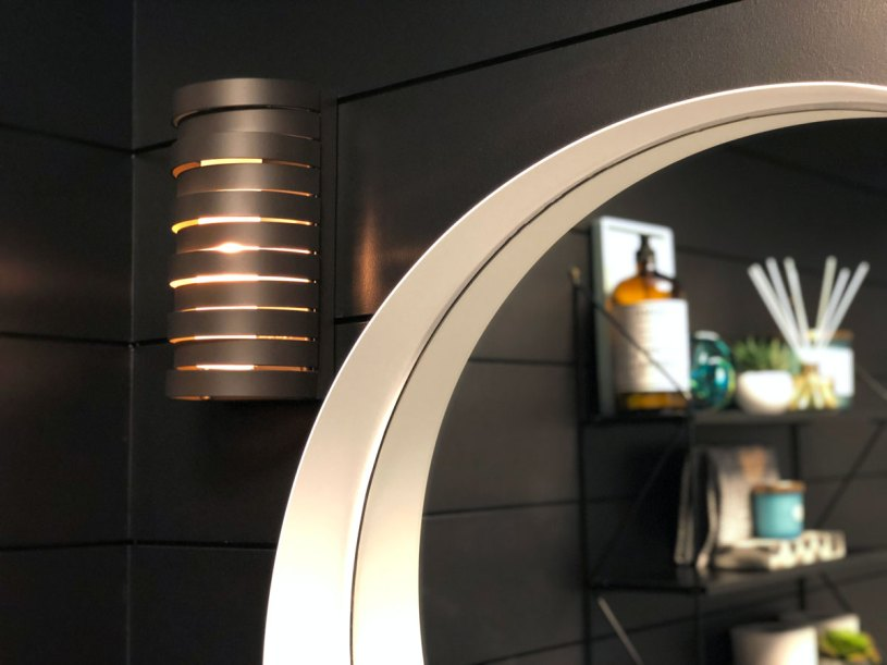 The Roswell sconces from Kichler add the perfect touch of gold to compliment the other elements in the space