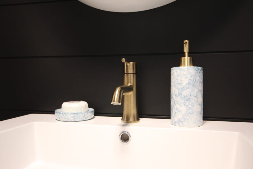 Delta Trinsic faucet in champagne gold coordinates nicely with the gold accent on the soap dispenser