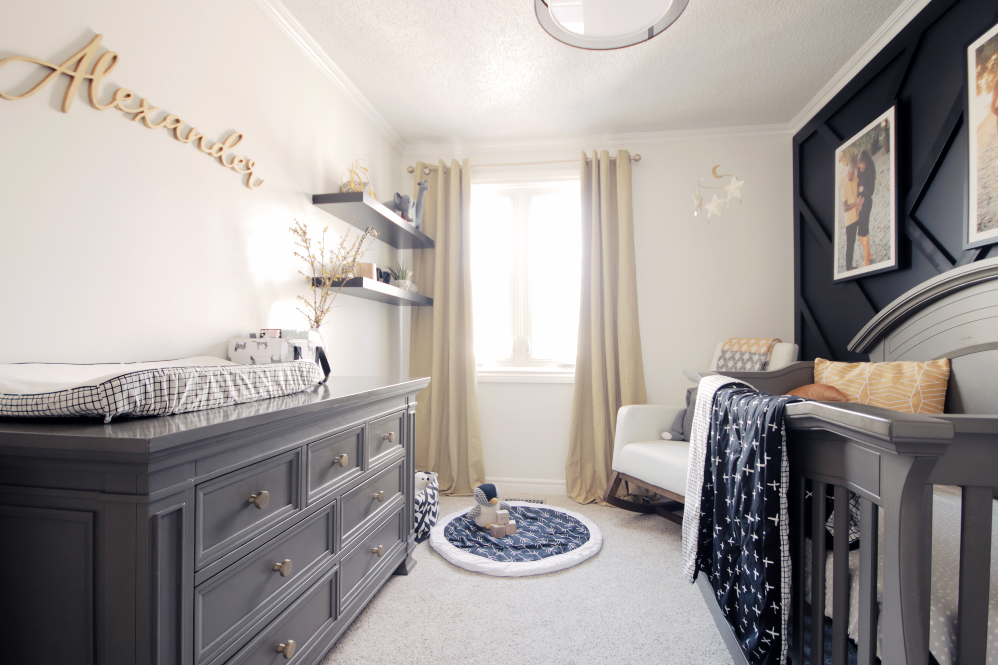 Contrasting light and dark walls in this warm elegant nursery reveal