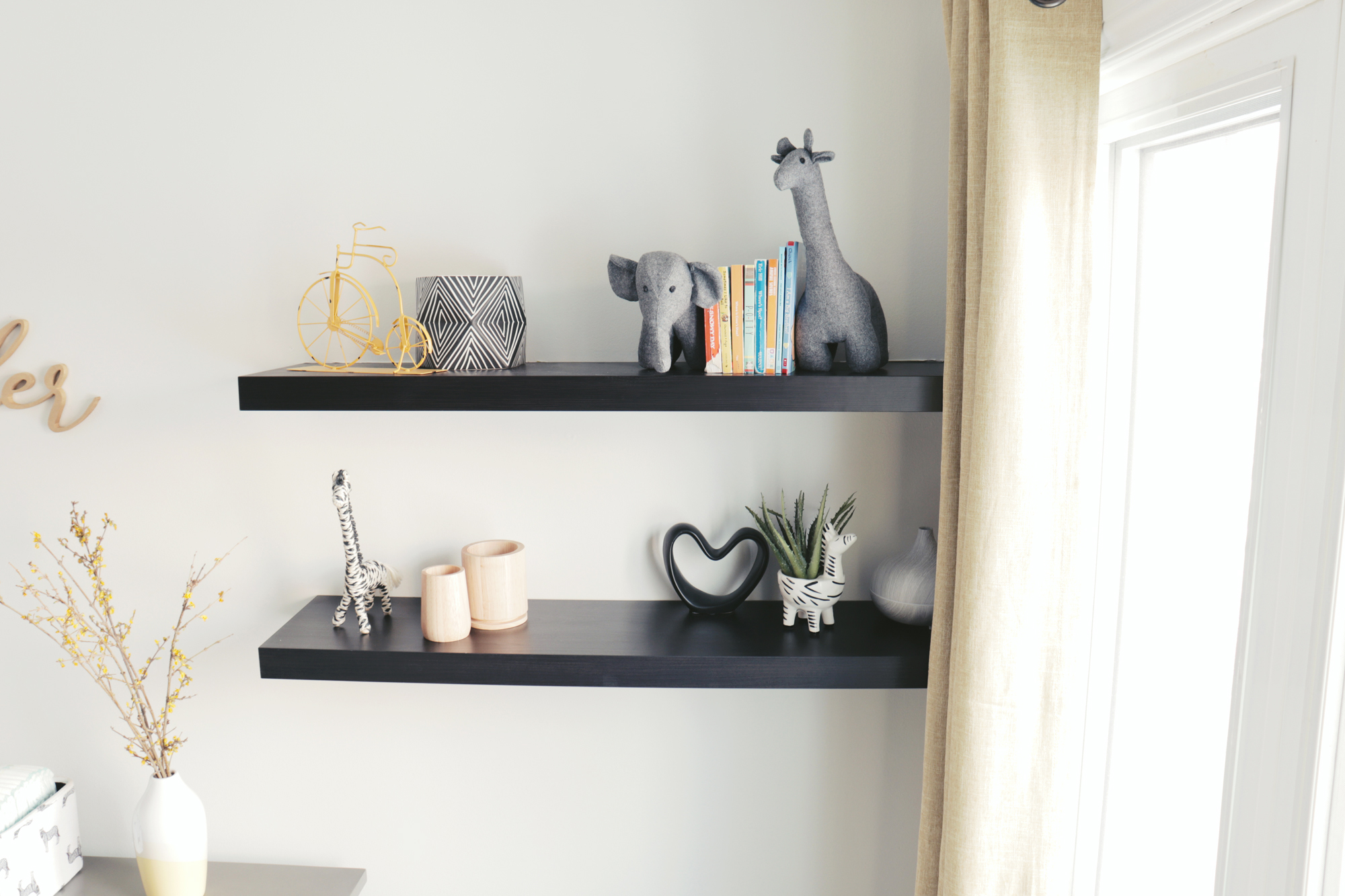 Floating shelves provide storage for decorative accents and books