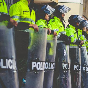 Row of police with shields, for meaning of police in a dream