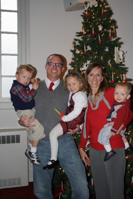 Family photo in front of tree at Little Church