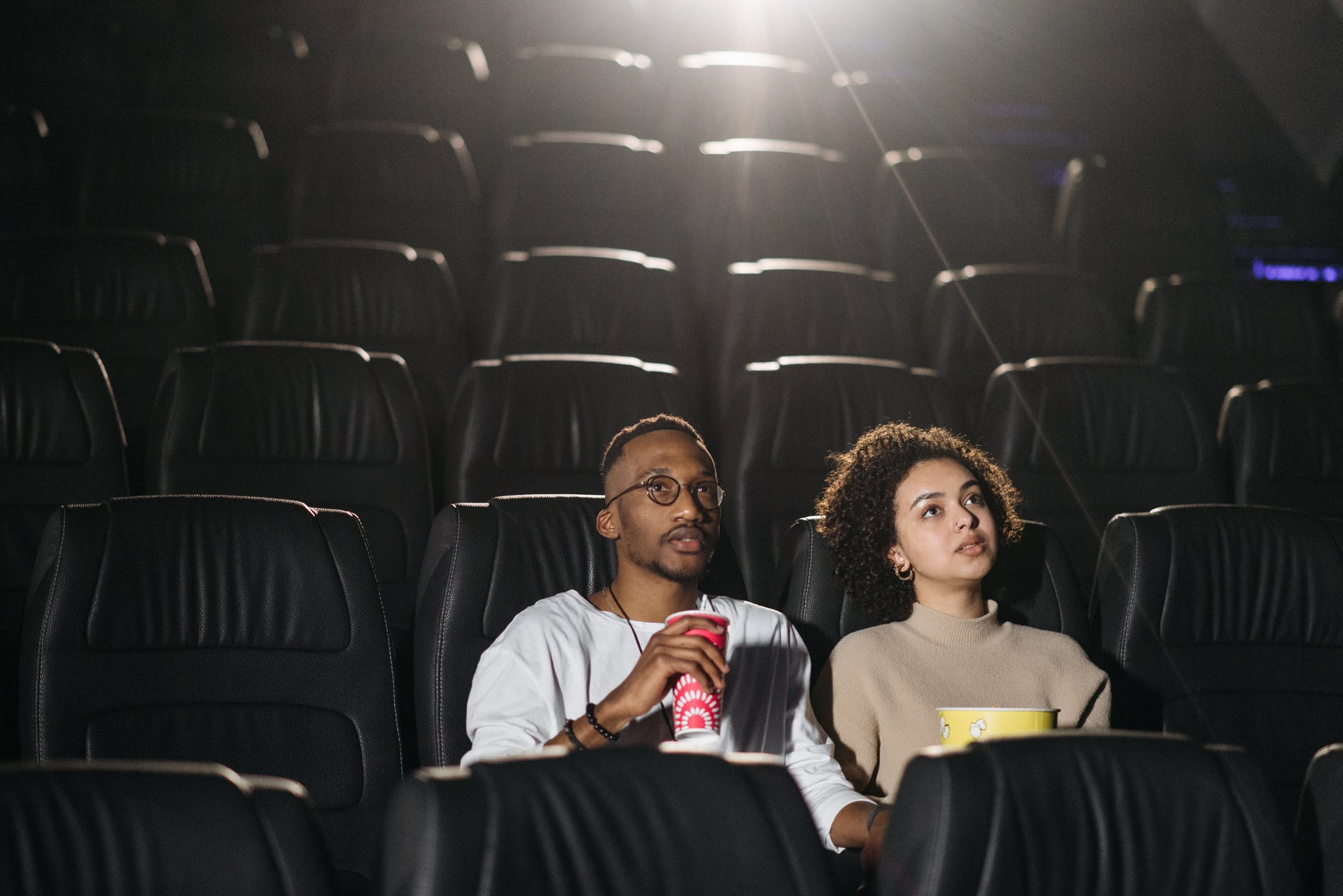 photo of a couple watching a movie in a cinema
