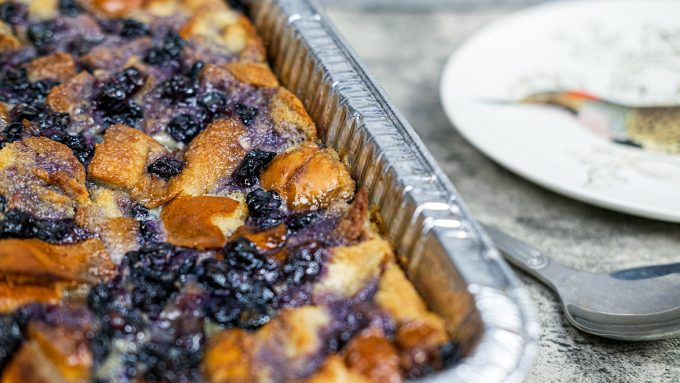 A close shot of the Baked Blueberry and Brioche French Toast casserole in a foil pan.
