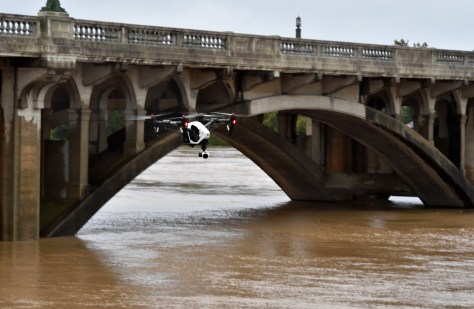 A drone flies over the waters of Congaree River in Columbia in South Carolina on October 5, 2015. Relentless rain left large areas of the US southeast under water. The states of North and South Carolina have been particularly hard hit, but the driving rain in recent days has spared almost none of the US East Coast.  AFP PHOTO/MLADEN ANTONOV        (Photo credit should read MLADEN ANTONOV/AFP/Getty Images)