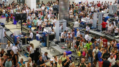 Airport security TSA remove drone from bag