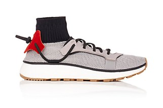 Thanks to a tip from one of our readers we have found two new silhouettes from the Alexander Wang x adidas Originals line. The images appear to have been uploaded to Barneys New York's online store before swiftly being taken down, confirming that these are indeed real silhouettes that'll be part of the duo's forthcoming Spring/Summer 2017 footwear offering. The first is a mixed material sneaker boasting part mesh, grained leather and knitted constructions placed atop of a BOOST midsole and stylish gum outsole. Stand out features include the sock-like entry point and unique lacing system that's adjoined at the back. Next up is a mid-cut silhouette which first made an appearance here, showing a leather/suede construction with an elastic ankle portion, all of which are rendered in black. A touch of gum can be found on the outsole as well. Priced at $230 USD and $260 USD respectively, look for the Mixed-Material and Leather and Suede sneakers to hit select accounts in the coming weeks.