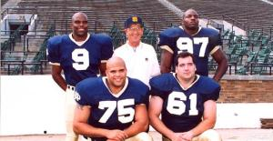 Lou Holtz with the captains of his 11-1 Notre Dame team in 1993: Jeff Burris (9), Bryant Young (97), Aaron Taylor (75) and Tim Ruddy (61). (Credit: http://notredame.247sports.com/)