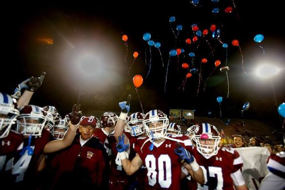 Jack Henzes, head coach of the Dunmore Bucks, celebrates his 400th win a 46-0 victory over Carbondale Area. (Photo Credit: Rich Banick)