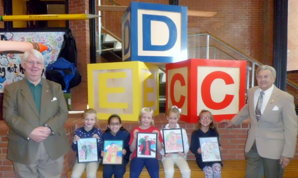 Second Grade students from the Dunmore Elementary Center classes won $25 Toys R Us gift certificates and had their winning entries professionally framed by Keystone UNICO member Jim Mack. The students are  pictured with Keystone UNICO representatives From left are: Mark McDade, UNICO PA II district governor; Fiona Hinton, Mya Harrity, Jaclyn Brown, Maeve Haggerty and Madilyn Keating, contest winners; and James Mack, coloring contest coordinator and Keystone UNICO board chairman.