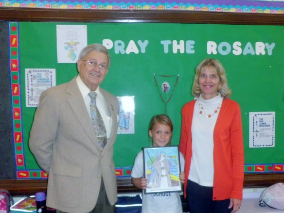 Pictured from left are James Mack, coloring contest coordinator and Keystone UNICO board chairman; coloring contest winner Claire Polishan; and Ms. Carol Lee McDonald, second grade teacher at Saint Mary's Parochial School.